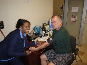 Harry gets a dose of good news on his progress from Nurse Manager Kimberly Council, RN, BSN.