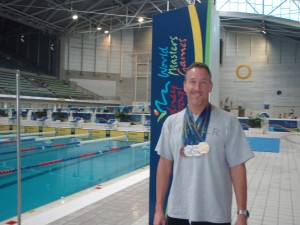 Scott at the 2009 World Masters Games in Sydney. Proudly displaying medals: Gold 100m Fly; Silver 50m Fly, 50m Free, 200m Free; and Bronze 100m Free.