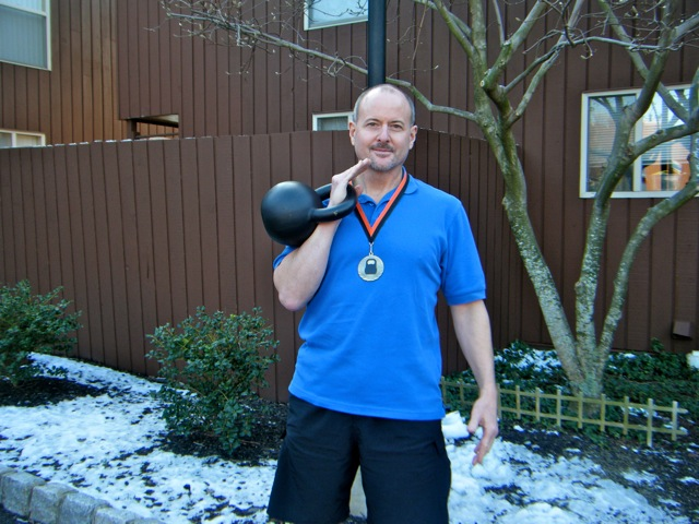 Rich sports his first-place medal won at the North Jersey Kettlebell Competition.