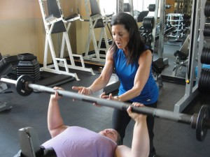 Trainer Jodi Strumeier motivates member Lisa Friedman as she reaches her goals one rep at a time.
