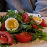 Add a protein perk to salads. Serve eggs with dark greens and tomatoes.