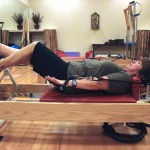Pegi works the Pilates circuit. Here, she tackles the reformer.