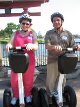 Blanche and her husband do Disney with segways.