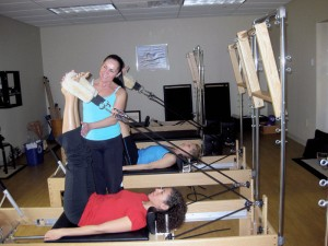 The Pilates Reformer may appear intimidating. Looks are deceiving. Stay in shape, even when you're down.
