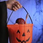 Hand Holding Halloween Bucket
