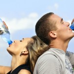 Couple, outdoors drinking water, pic