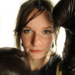 woman-with-large-boxing-gloves-pic-640x330