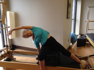 Marian using the Pilates reformer.